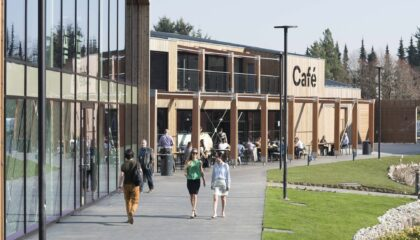 people walking towards cafe in Croxley Park, property managed by Workman LLP